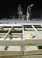 US Navy 080425-N-2446C-002 Seabees assigned to Naval Mobile Construction Battalion (NMCB) 3 work late into the night to complete the floor of a Southwest Asia hut.jpg