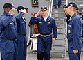 US Navy 080724-N-1082Z-006 Cmdr. Peter G. Galluch salutes as he passes through side boys during his arrival for the change of command.jpg