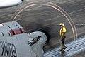 US Navy 080831-N-1635S-003 An aviation boatswain's mate (handling) guides an E-2C Hawkeye.jpg