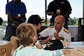 US Navy 080924-N-2539L-012 Rear Adm. John Goodwin speaks with patients at Palmetto Health Children's Hospital.jpg