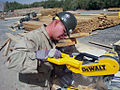 US Navy 081007-N-4107C-001 torekeeper Seaman Patrick Joynt cuts lumber during the prefabrication phase of construction for a.jpg