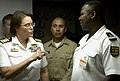 US Navy 090205-N-3316L-028 Capt. Cindy Thebaud, commanding officer of Africa Partnership Station speaks with an embarked trainee during a shipboard indoctrination class aboard the amphibious transport dock ship USS Nashville (L.jpg