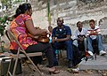 US Navy 090411-A-4455C-001 U.S. Public Health Service Lt. Mivoyel Jean Paul visits with his family in Port-Au-Prince during a break in his duties while deployed as part of the staff of Continuing Promise 2009.jpg
