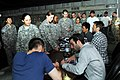 US Navy 090412-N-0636S-002 Cast members from the new Star Trek movie, from left, Chris Pine, Zachary Quinto, Karl Urban, and John Cho sign autographs at a U.S. military base in the Middle East.jpg