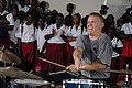 US Navy 090428-N-1688B-109 Musician 3rd Class Jason McDonough performs while surrounded by students from Lycee Primary School in Port Gentil, Gabon.jpg