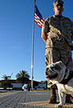 US Navy 090702-N-3289E-100 Marine Corporal Dustin Shanle stands in front of the Naval Station Rota Spain, flagpole with company mascot Monster during the annual flag raising ceremony.jpg