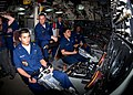 US Navy 100308-N-9588L-023 Machinist's Mate 3rd Class Joan Valles, left, mans the helm of the Ohio-class guided-missile submarine USS Florida (SSGN 728).jpg