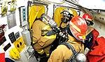 US Navy 100309-N-4774B-136 Sailors conduct firefighting drills during a training evolution.jpg