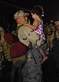 US Navy 100402-N-7084M-349 A Seabee assigned to Naval Mobile Construction Battalion (NMCB) 74 is welcomed home by his daughter at Naval Construction Battalion Center, Gulfport.jpg