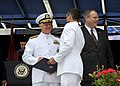 US Navy 100528-N-8273J-138 Chief of Naval Operations (CNO) Adm. Gary Roughead congratulates newly commissioned Navy ensigns during the U.S. Naval Academy Class of 2010 graduation and commissioning ceremony.jpg