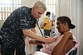 US Navy 100809-N-9964S-177 Cmdr. Timothy Burgess, embarked aboard the multipurpose amphibious assault ship USS Iwo Jima (LHD 7), conducts medical examinations during a Continuing Promise 2010 medical community service event.jpg