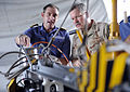 US Navy 100818-N-8959T-184 Vice Adm. Mark Fox, right, discusses the capabilities and operation of the mine neutralizer vehicle, Sea Fox, with Lt. Cmdr. Adam Northover.jpg