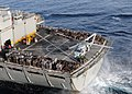 US Navy 101027-N-0126S-012 A MH-60S helicopter assigned to the Golden Falcons of Helicopter Sea Combat Squadron (HSC-12) lifts a pallet of cargo fr.jpg