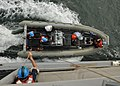 US Navy 110511-N-NL541-071 Boatswain's mates recover a rigid-hull inflatable boat aboard the guided-missile frigate USS Thach (FFG 43).jpg