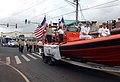 US Navy 111105-N-YU572-108 Sailors from the Pacific Missile Range Facility wave to spectators during the annual Kauai Veterans Day Parade.jpg