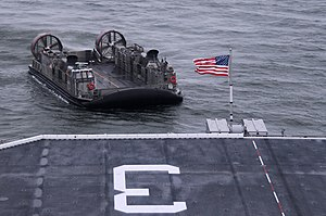 US Navy 120111-N-SB587-058 A landing craft air cushion approaches the well deck of the amphibious assault ship USS Kearsarge (LHD 3).jpg