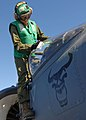 US Navy 120130-N-OR551-039 A Sailor cleans the cabin of an aircraft.jpg