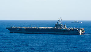 US Navy 120214-N-OY799-100 The Nimitz-class aircraft carrier USS John C. Stennis (CVN 74) and the Arleigh Burke-class guided-missile destroyer USS.jpg