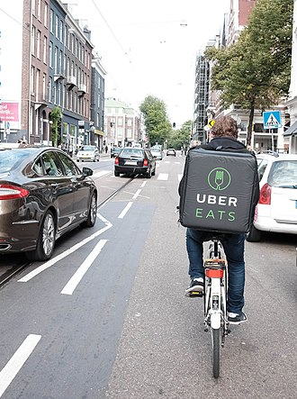 Food delivery - UberEATS delivery person on a bicycle.