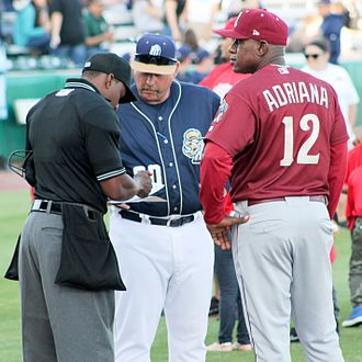 Umpire (baseball) - Home plate umpire Malachi Moore reviews the lineup cards from both teams before a 2016 minor league baseball game