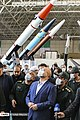 Unidentified Iranian officials and missiles.jpg