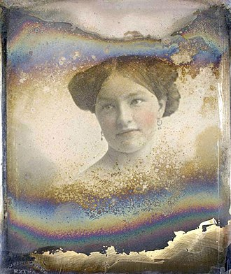 Hand-colouring of photographs - A tarnished hand-coloured daguerreotype (c. 1852) from the George Eastman House in Rochester, NY.