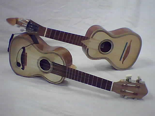 Cavaquinho small plucked string instrument of the European guitar family