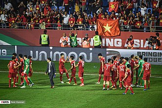 Vietnam national football team - Scenes during the quarter-finals of 2019 AFC Asian Cup. Clockwise from top: Vietnamese team with Japan at the cup quarter-finals and Vietnamese fans during the match.