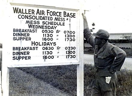 A soldier at Waller Air Force Base, leased by Britain to America in the 1940s Waller AFB mess hall sign.jpg