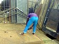 Welder smoothing the surface of a gate.jpg
