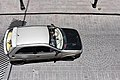 White car with black hood passing.jpg