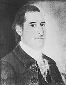 Sepia-tone print shows a dark-haired and clean-shaven man with a large nose. He wears a dark coat and a white collar.
