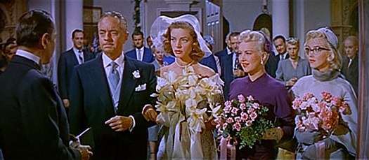 William Powell as J.D. Hanley prepares to marry Schatze, with Loco and Pola as bridesmaids. William Powell, Lauren Bacall, Betty Grable and Marilyn Monroe in How to Marry a Millionaire trailer.jpg