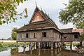 Wooden buddhist house of Don Loppadi.jpg