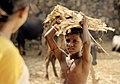 Yadigiri, a farmhand, challenges Vanaja when she hangs her clothes on the landlady's line.jpg