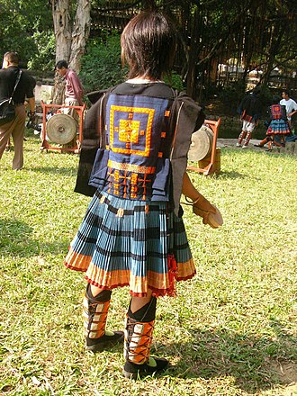 Yao people - The back of a child in China in Yao traditional dress