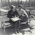 Young woman and man braille reading on park bench (4926954971).jpg