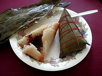 Zongzi - Zongzi both ready to eat (left) and still wrapped in a bamboo leaf (right)