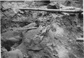 """""""A 2x6 inch sawed plank imbedded under the river fill gravel over the edge of the bench on the Nevada side of the... - NARA - 293850.tif"""
