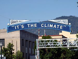 "Grants Pass downtown, ""It's The Climate"" sign"