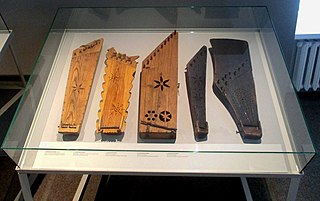 Kanklės Lithuanian plucked string instrument (chordophone) belonging to the Baltic box zither family known as the Baltic psaltery