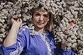 День Вишиванки. Молода україночка у вишитій синій сукні серед квітів 08.jpg