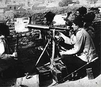Reza Shah - Reza Pahlavi behind a machine gun