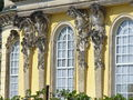 1022.Die mit 36 Bacchantenhermen und Bachantinnen beschmückte Südfassade Sanssoucis Steffen Heilfort.JPG