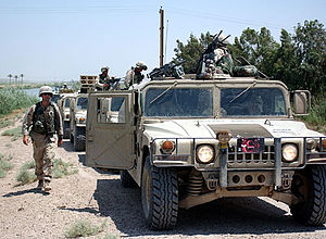 Iraq War in Anbar Province - American soldiers with the 115th Military Police Company operating near Fallujah in June 2003. These particular soldiers are using unarmored Humvees.