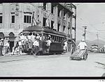 131784 ONE OF THE BATTERED TRAMS LEFT IN THE AREA CARRYING ITS USUAL OVERLOAD OF PASSENGERS.JPG