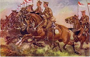 2nd (Sialkot) Cavalry Brigade - The 17th Lancers advancing, wearing their early-war uniform, postcard after Harry Payne