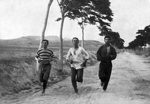"Athens Classic Marathon - Burton Holmes' photograph entitled ""1896: Three athletes in training for the marathon at the Olympic Games in Athens"". The 1896 Olympic Marathon was the precursor to the Athens Classic Marathon."