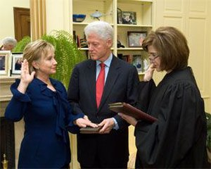 Hillary Clinton's tenure as Secretary of State - Clinton takes the oath of office as Secretary of State, administered by Associate Judge Kathryn Oberly as Bill Clinton holds the Bible.