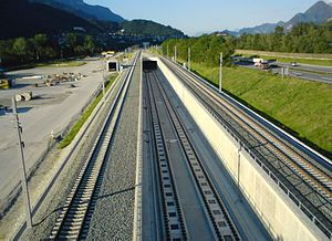 New Lower Inn Valley railway - Looking east: the middle tracks are the end of the Münsterer tunnel, part of the Stans link. The outside tracks are the new route of the original line, which has been in operation since 15 August 2011